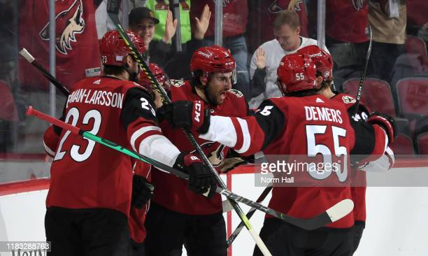 Oliver EkmanLarsson Conor Garland Nick Schmaltz Jason Demers and Christian Dvorak of the Arizona Coyotes celebrate after Garland's goal against the...
