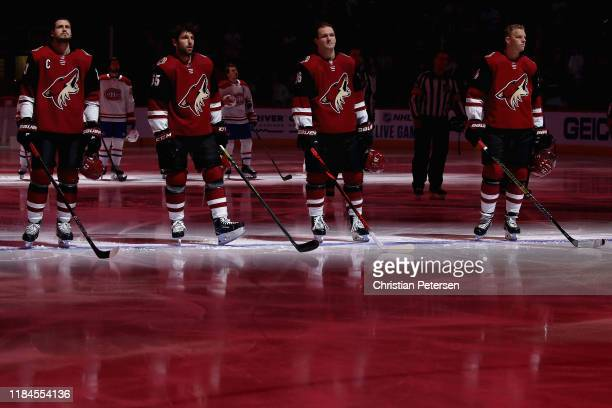 Oliver Ekman-Larsson, Jason Demers, Christian Fischer and Carl Soderberg of the Arizona Coyotes stand attended for the Canadian national anthem...