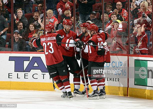 Oliver EkmanLarsson Martin Hanzal Alex Tanguay and Max Domi of the Arizona Coyotes celebrate with teammate Anthony Duclair after Duclair's second...
