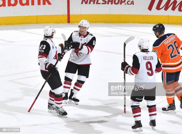 Oliver EkmanLarsson Max Domi and Clayton Keller of the Arizona Coyotes celebrate after a goal during the game against the Edmonton Oilers on November...