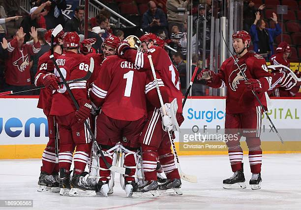 Oliver EkmanLarsson Mike Ribeiro Antoine Vermette goaltender Thomas Greiss Shane Doan and David Moss of the Phoenix Coyotes celebrate after defeating...