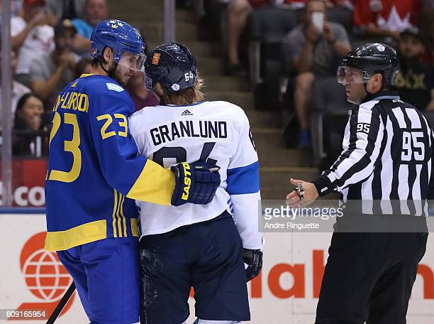 Oliver EkmanLarsson of Team Sweden discusses his tripping penalty with Mikael Granlund of Team Finland during the World Cup of Hockey 2016 at Air...