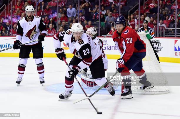 39afe264f50 Oliver EkmanLarsson of the Arizona Coyotes and Lars Eller of the Washington  Capitals battle for the