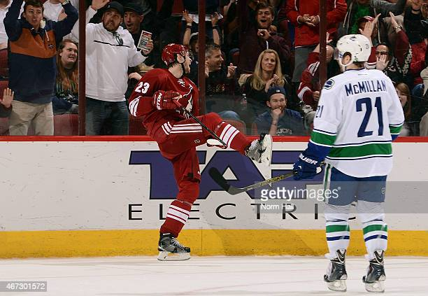 Oliver EkmanLarsson of the Arizona Coyotes celebrates his goal as Brandon McMillan of the Vancouver Canucks looks on during the first period at Gila...