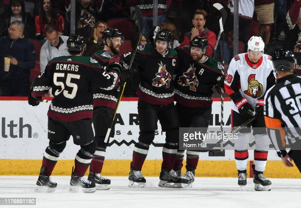 Oliver EkmanLarsson of the Arizona Coyotes celebrates with teammates Jason Demers Derek Stepan and Phil Kessel after scoring a goal against the...