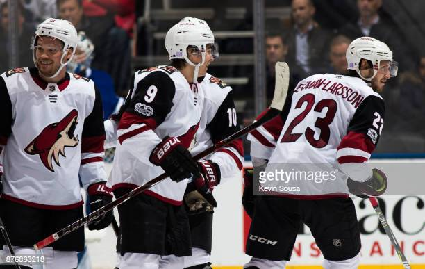 Oliver EkmanLarsson of the Arizona Coyotes celebrates with teammates Max Domi Clayton Keller and Anthony Duclair after scoring on the Toronto Maple...