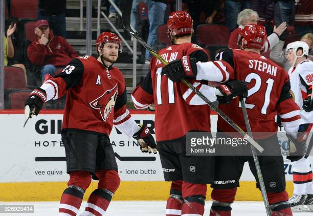 Oliver EkmanLarsson of the Arizona Coyotes celebrates with teammates Brendan Perlini and Derek Stepan after his first period goal against the Ottawa...
