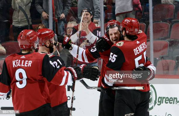 Oliver EkmanLarsson of the Arizona Coyotes celebrates with teammates Clayton Keller Derek Stepan and Jason Demers after scoring a goal against the...