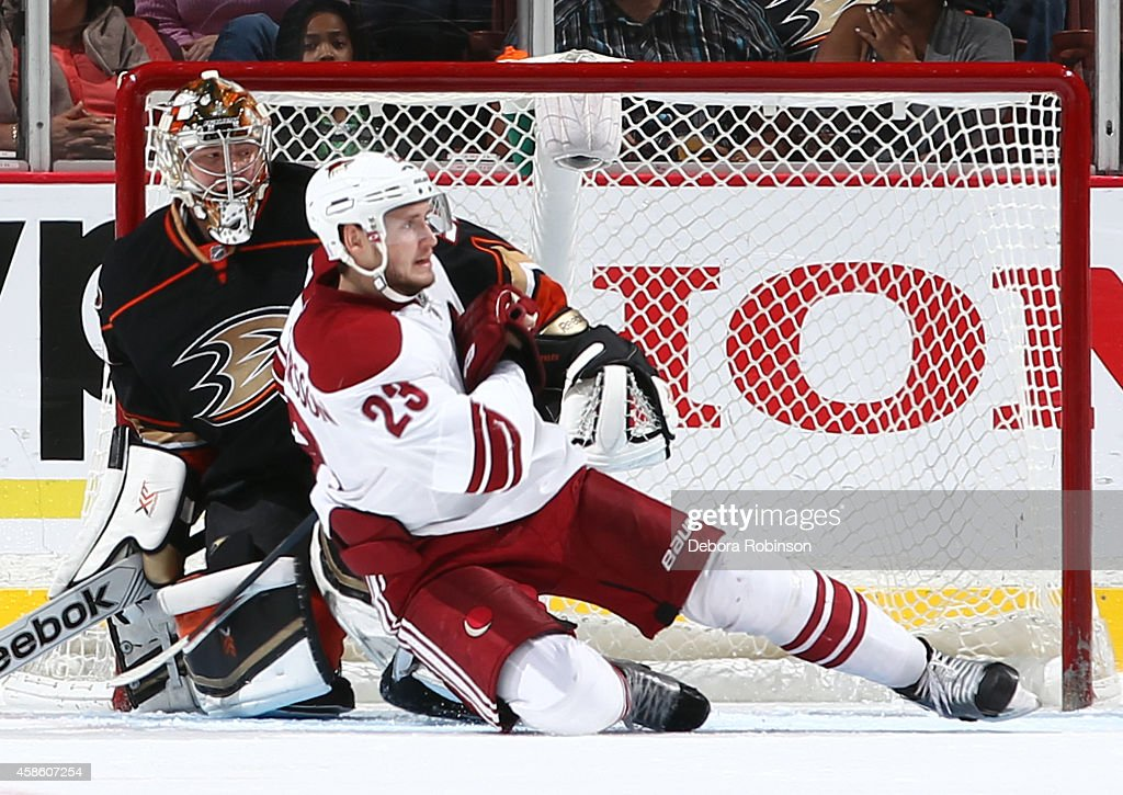 Oliver Ekman-Larsson #23 of the Arizona Coyotes collides into Jason LaBarbera #30 of the Anaheim Ducks on November 7, 2014 at Honda Center in Anaheim, California.