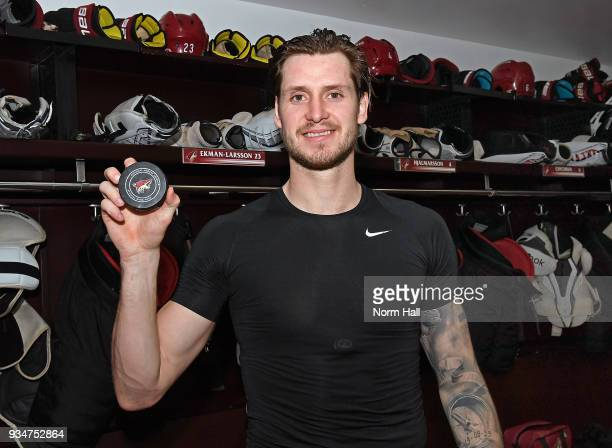 Oliver EkmanLarsson of the Arizona Coyotes holds the puck from his 100th career NHL goal which he scored during a 52 victory against the Calgary...