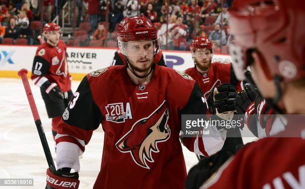 Oliver EkmanLarsson of the Arizona Coyotes is congratulated by teammates after scoring a second period goal against the Chicago Blackhawks at Gila...