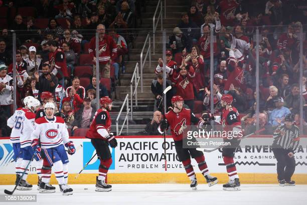 Oliver EkmanLarsson of the Arizona Coyotes is congratulated by Christian Fischer and Alex Galchenyuk after scoring a power play goal against the...