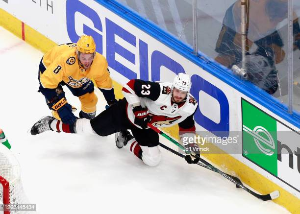 Oliver Ekman-Larsson of the Arizona Coyotes is tripped up by Kyle Turris of the Nashville Predators during the second period in Game One of the...