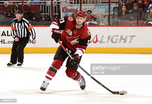 Oliver EkmanLarsson of the Arizona Coyotes passes the puck up ice against the Edmonton Oilers at Gila River Arena on December 21 2016 in Glendale...