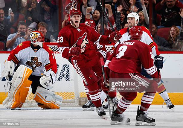 Oliver EkmanLarsson of the Arizona Coyotes reacts after scoring the game winning overtime goal past goaltender Roberto Luongo of the Florida Panthers...