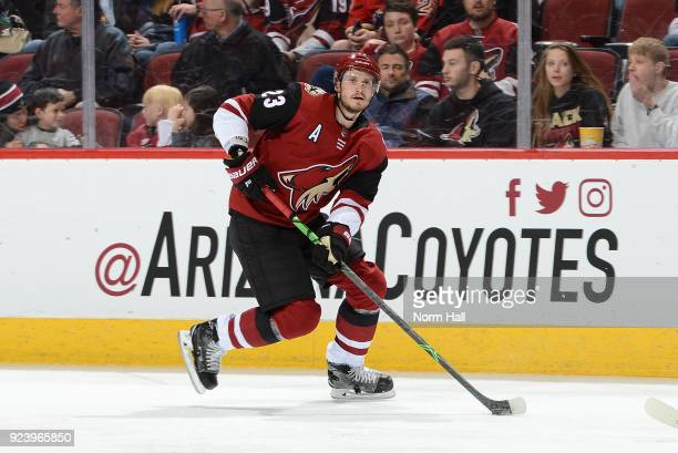 Oliver EkmanLarsson of the Arizona Coyotes skates the puck up ice against the Calgary Flames at Gila River Arena on February 22 2018 in Glendale...