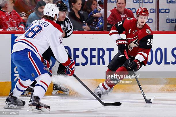 Oliver EkmanLarsson of the Arizona Coyotes skates with the puck during the NHL game against the Montreal Canadiens at Gila River Arena on February 15...