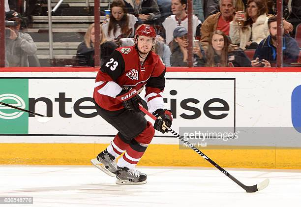 Oliver EkmanLarsson of the Arizona Coyotes skates with the puck against the Edmonton Oilers at Gila River Arena on December 21 2016 in Glendale...