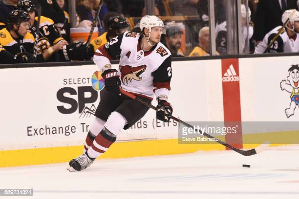 Oliver EkmanLarsson of the Arizona Coyotes skates with the puck against the Boston Bruins at the TD Garden on December 7 2017 in Boston Massachusetts