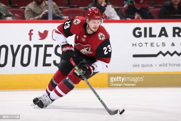 Oliver EkmanLarsson of the Arizona Coyotes skates with the puck during the NHL game against the New York Islanders at Gila River Arena on January 22...