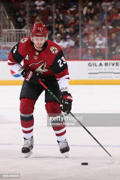 Oliver EkmanLarsson of the Arizona Coyotes skates with the puck during the first period of the NHL game against the New York Islanders at Gila River...