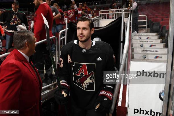 Oliver EkmanLarsson of the Arizona Coyotes takes the ice wearing a special Arizona Diamondbacks style warm up jersey prior to a game against the...