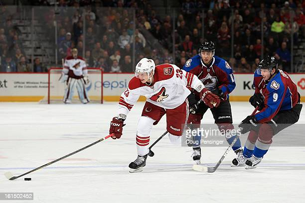 Oliver EkmanLarsson of the Phoenix Coyotes collects the puck against Matt Duchene of the Colorado Avalanche and Aaron Palushaj of the Colorado...