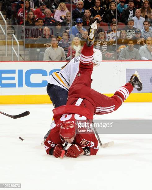 Oliver EkmanLarsson of the Phoenix Coyotes goes head first into the ice over Steve Montador of the Buffalo Sabres on January 8 2011 at Jobingcom...