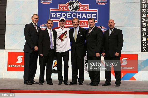 Oliver EkmanLarsson poses for a photo with members of the Phoenix Coyotes organization Assistant GM Brad Treliving Director of Amateur Scouting Keith...