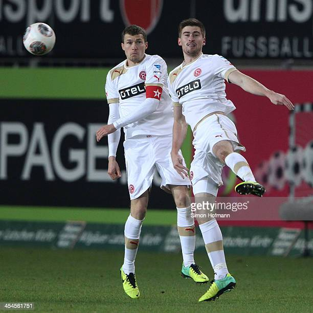 Oliver Fink jumps for a header with hin team mate Dustin Bomheuer of Duesseldorf during the Second Bundesliga match between 1 FC Kaiserslautern and...
