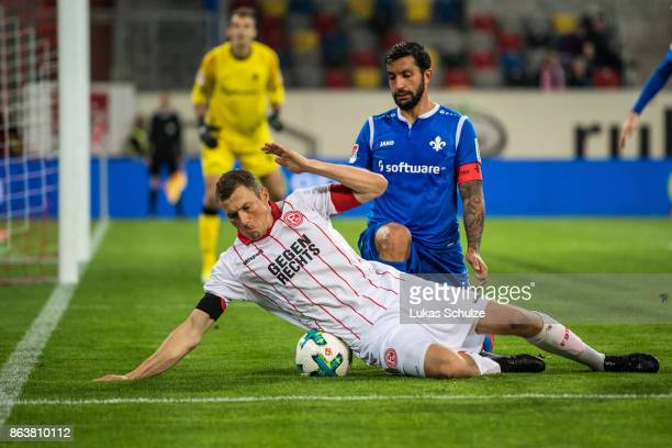 Oliver Fink of Duesseldorf and Aytac Sulu of Darmstadt fight for the ball during the Second Bundesliga match between Fortuna Duesseldorf and SV...