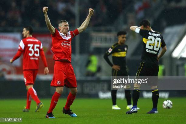 Oliver Fink of Duesseldorf celebrates scoring the 2nd team goal whilst Christian Gentner team captain of Stuttgart looks dejected during the...