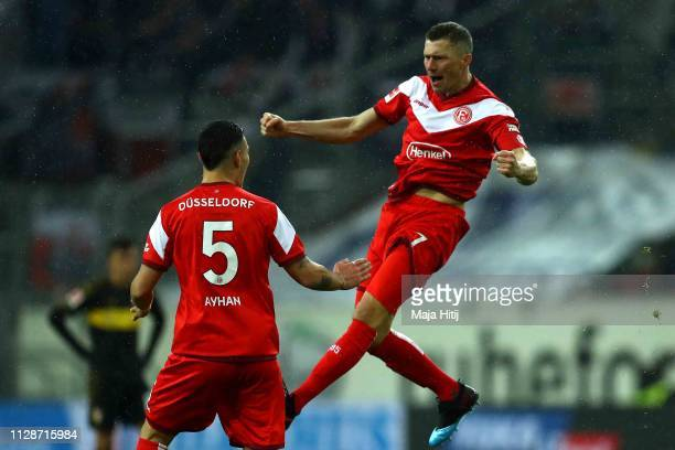 Oliver Fink of Duesseldorf celebrates scoring the 2nd team goal with his team mate Kaan Ayhan during the Bundesliga match between Fortuna Duesseldorf...