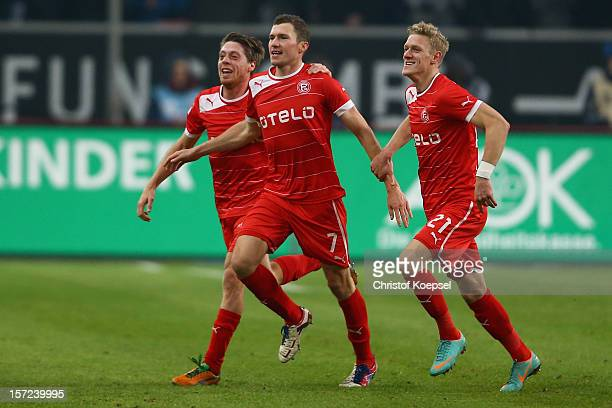 Oliver Fink of Duesseldorf celebrates the second goal with Andreas Lambertz and Johannes van den Bergh of Duesseldorf during the Bundesliga match...