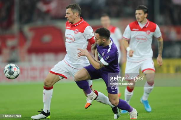 Oliver Fink of Fortuna Duesseldorf battles for possession with Calogero Rizzuto of Erzgebirge Aue during the DFB Cup second round match between...