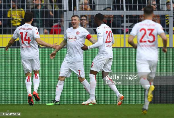 Oliver Fink of Fortuna Duesseldorf celebrates with teammates Markus Suttner and Dodi Lukebakio after scoring his team's first goal during the...
