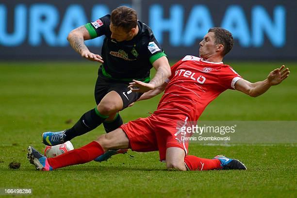 Oliver Fink of Fortuna Duesseldorf challenges Marko Arnautovic of Werder Bremen during the Bundesliga match between Fortuna Duesseldorf 1895 and SV...