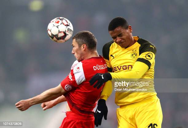 Oliver Fink of Fortuna Duesseldorf competes for a header with Manuel Akanji of Borussia Dortmund during the Bundesliga match between Fortuna...