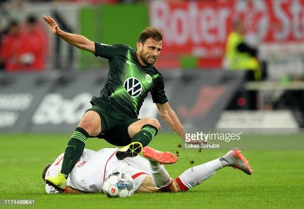 Oliver Fink of Fortuna Duesseldorf is challenged by Admir Mehmedi of VfL Wolfsburg during the Bundesliga match between Fortuna Duesseldorf and VfL...