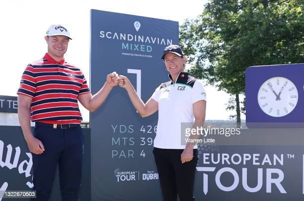 Oliver Fisher of England and Annika Sorenstam of Sweden pose for a picture on the first tee as the only members of their respective European Tour and...