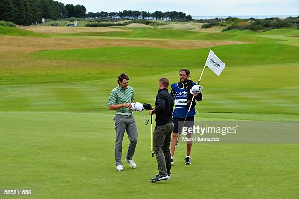 Oliver Fisher of England and Peter Uihlein of United States shake hands on the green of hole 18 after their four hole playoff on day one of the...