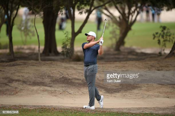 Oliver Fisher of England hits an approach shot on the 5th hole during the third round of the Commercial Bank Qatar Masters at Doha Golf Club on...