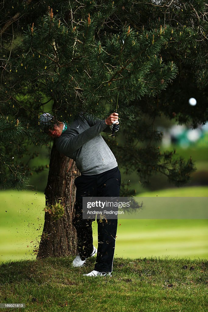 Oliver Fisher of England hits his 2nd shot on the 9th hole during the first round of the BMW PGA Championship on the West Course at Wentworth on May 23, 2013 in Virginia Water, England.