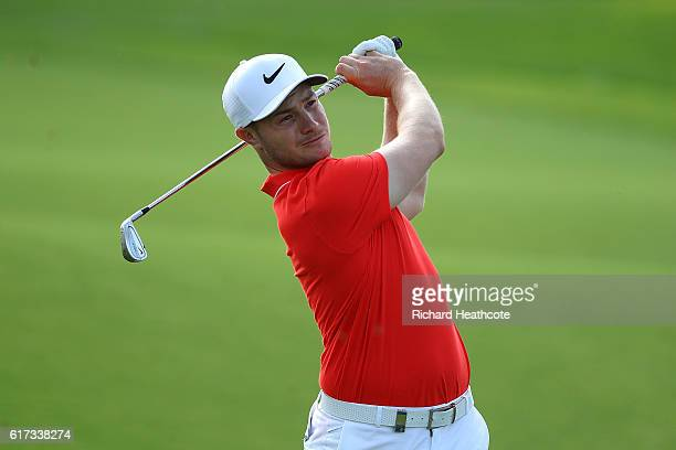 Oliver Fisher of England hits his second shot on the 3rd hole during day four of the Portugal Masters at Victoria Clube de Golfe on October 23 2016...