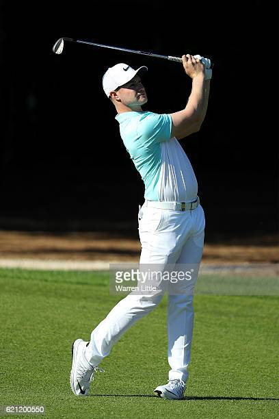 Oliver Fisher of England hits his second shot on the 4th hole during day three of the Turkish Airlines Open at the Regnum Carya Golf Spa Resort on...