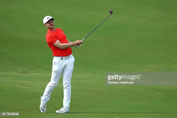 Oliver Fisher of England hits his second shot on the 5th hole during day four of the Portugal Masters at Victoria Clube de Golfe on October 23 2016...