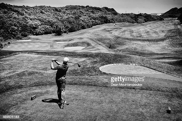Oliver Fisher of England hits his tee shot on the 3rd hole during the Final Round of the Africa Open at East London Golf Club on February 16 2014 in...