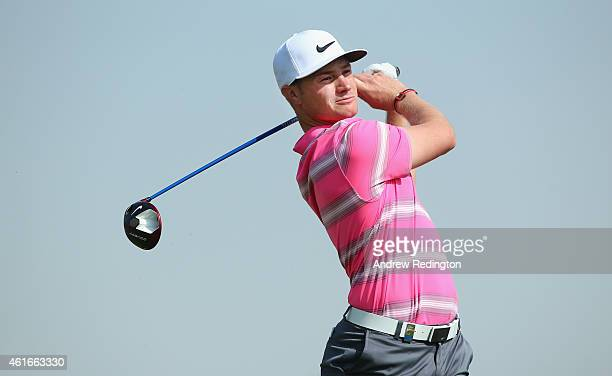 Oliver Fisher of England hits his tee shot on the third hole during the third round of the Abu Dhabi HSBC Golf Championship at the Abu Dhabi Golf Cub...