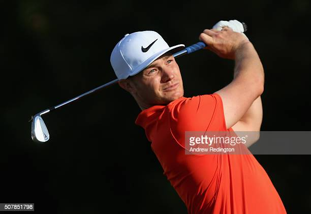 Oliver Fisher of England hits his teeshot on the fourth hole during practice for the 2016 Omega Dubai Desert Classic on the Majlis Course at the...