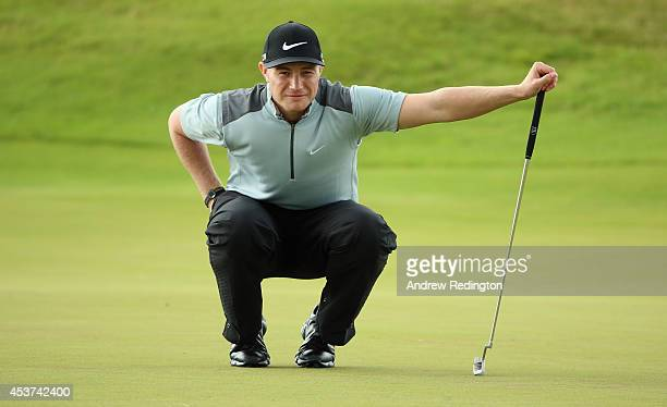 Oliver Fisher of England in action during the final round of the Made In Denmark at Himmerland Golf Spa Resort on August 17 2014 in Aalborg Denmark